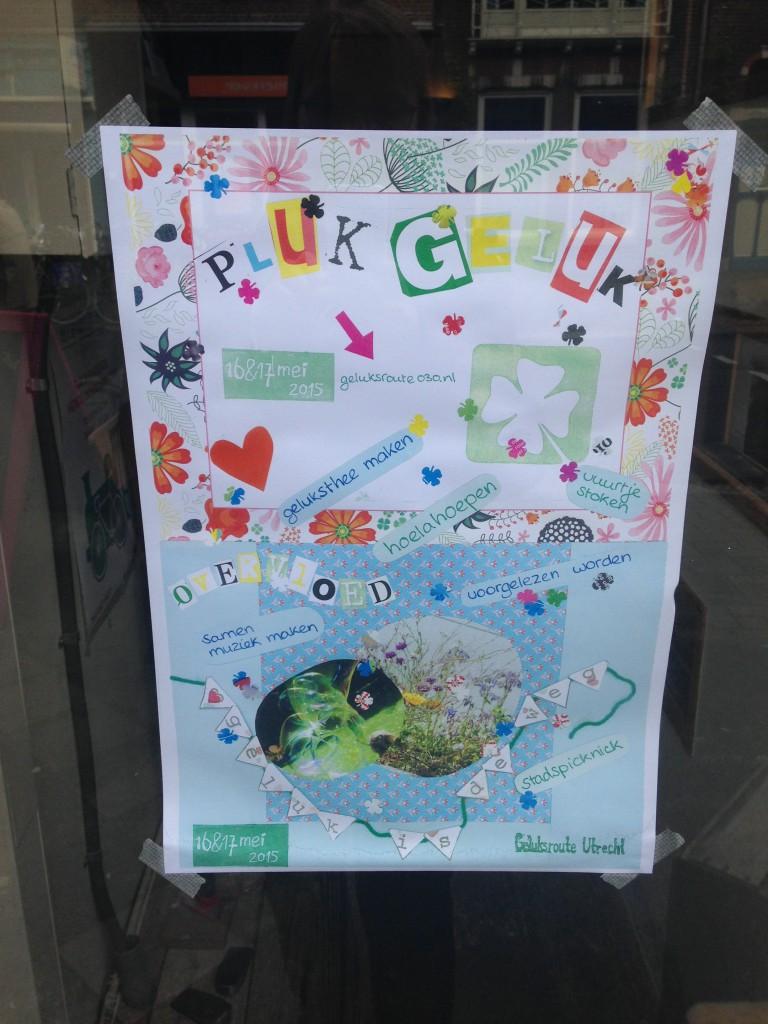 Poster Geluksroute op de deur bij HOOI